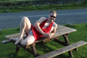 Stig in red dress on picnic table